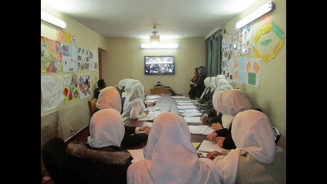 Afghan students engage with their US peers during a videoconference, part of a yearlong virtual exchange program with Global Nomads Group.