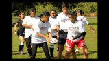 Hawaiian girls learn proper rugby passing skills at the Game Plan Rugby Academy.