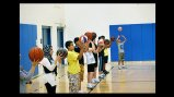 The participants practice ball skills with Brett Issacson of One-on-One Basketball.