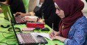 Muslim girl looking at laptop