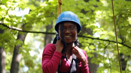 Anita smiles proudly when completing a challenging high ropes course during her exchange.
