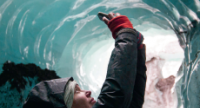 Woman taking photo in Ice Cave