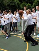President Obama joins young Russian basketball players from the U.S.-Russia Bilateral Presidential Commission's Youth Basketball Exchange for a game. May 25, 2010.