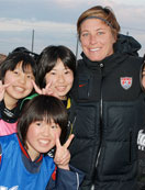 U.S. forward Abby Wambach meets some potential future members of Japan's national soccer team.