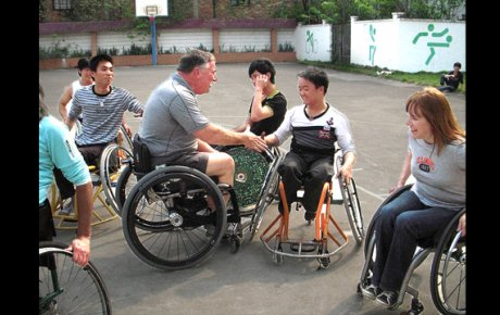 Participants from Mobility International USA and Guangzhou English Training Center (GETCH) students work together on the court.