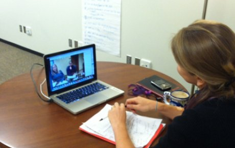 Photo of Amy Carrdus facilitating virtual exchange with Gold Star participants, and MCID