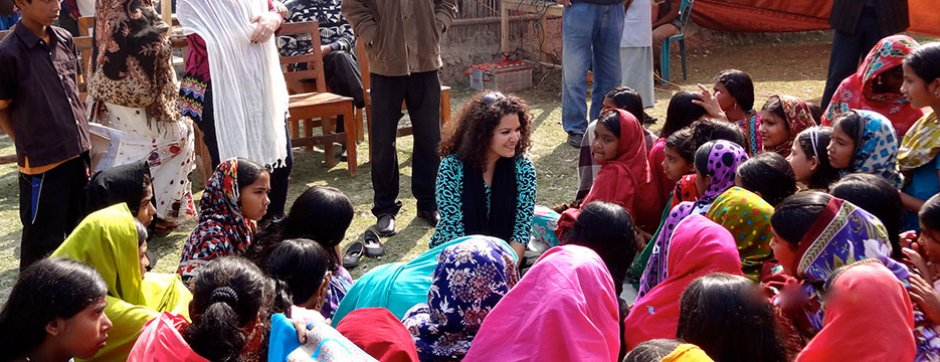 Fulbrgiht participant sitting with children
