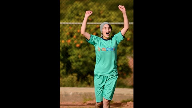 Moroccan clinic participant celebrates after winning a soccer match.