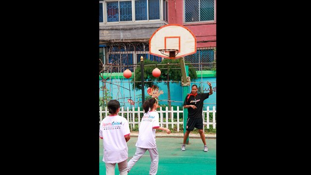 Kiesha Brown leads a shooting drill with girls from the Shenhe Migrant Workers Elementary School in China.