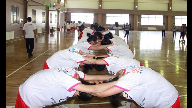 The girls warm up for a clinic at Guangquan Rural School in China.