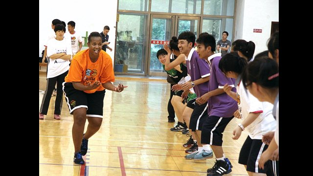 Tamika Raymond runs defense drills with the students from Benxi No. 1 High School in China.