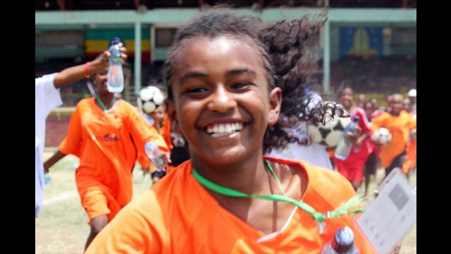 An Ethiopian girl finishes up a warm-up run.