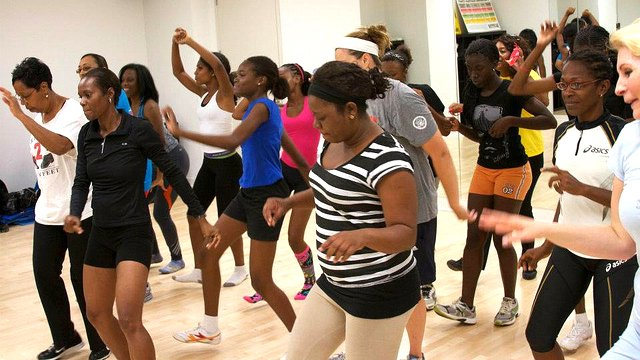 The Caribbean track and field visitors take part in a D.C.-area YWCA line dancing class.