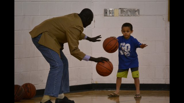 One of the coaches from South Sudan works on dribbling drills with a young athlete in Washington, D.C.