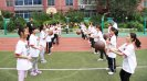 Tamika Raymond's husband, Ben Raymond, teaches passing drills to girls from the Shenhe Migrant Workers Elementary School in China.