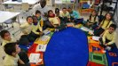 The South Sudanese basketball coaches visit a D.C.-area kindergarten class to learn about the U.S. school system.