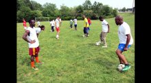 Swaziland coaches practicing with the varsity soccer team from C.D. Hylton High School.