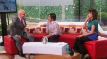 Chairman Tom Healy enjoys a conversation with Fulbright alum Ahmad Fuadi while taping a news show in Jakarta, Indonesia. Faudi is an award-winning novelist and has worked to provide education to underprivileged preschool children.