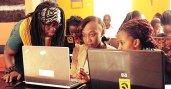 Fulbright U.S. Student alumna Joy Buolamwini (left) empowers women through technology education.