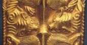 Gold plaque showing four tigers eating an ox Warring States(475-221 BC)Length 12.7 cm, Width 7.4 cm, Weight 237.625 g Excavated in 1972 from Aluchaideng, Hanggin Banner, Inner Mongolia