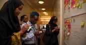 Mandela Washington Fellows brainstorming at the feedback wall.