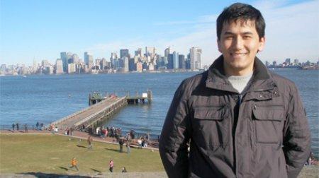 Nodirjon poses on Ellis Island in New York City, NY.